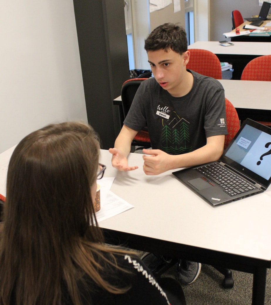 caption: Barak Horowitz, a 10th grader at Sammamish High School in Bellevue, speaks with a visitor about anxiety disorder at the school's recent Health and Wellness Night