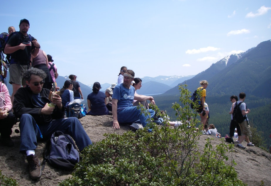 caption: Hikers at Rattlesnake Ledge. The number of visitors to this trail have been increasing over the last years.