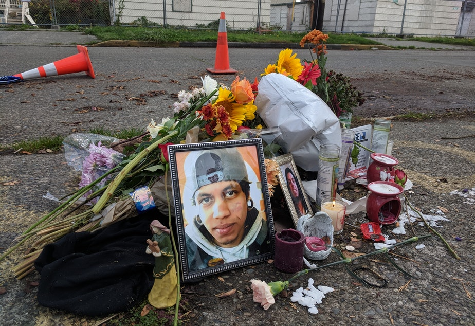 caption: Friends leave flowers near the spot where Daniel Alberto was shot in North Seattle