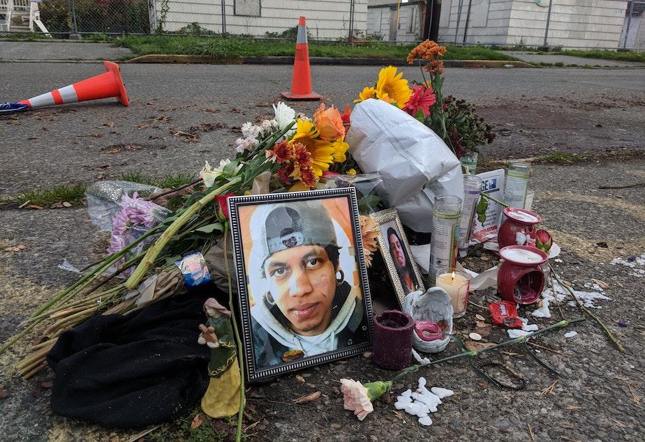 Friends leave flowers near the spot where Daniel Alberto was shot in North Seattle