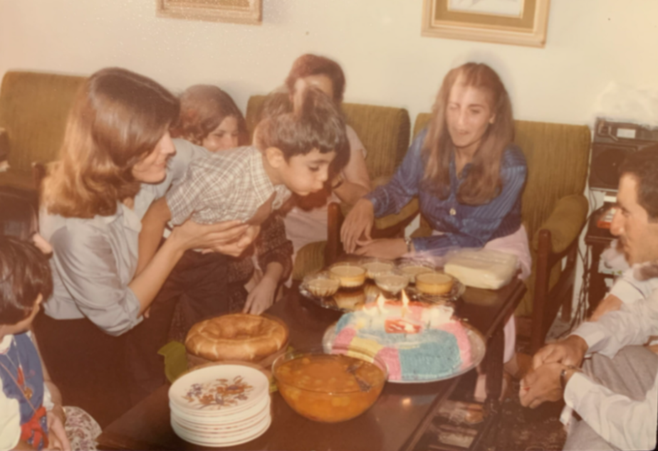 caption: Zaki Hamid blows out the candles on his sixth birthday cake at his family's apartment in Amman, Jordan. Hamid's family moved to the West Bank from Palestine in 1948. The family then moved to Jordan after the Six-Day War in 1967.