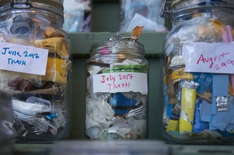 Jars filled with the garbage that Deb Seymour has accumulated over each month of 2017 are shown at her home on Wednesday, December 20, 2017, in Seattle.