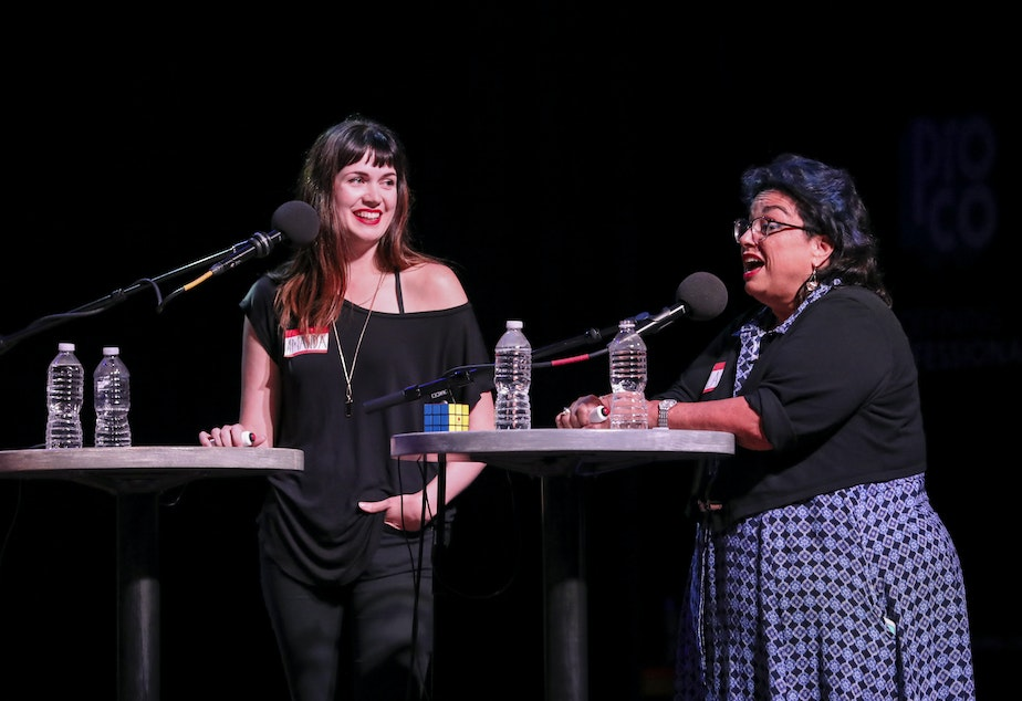 Contestants Amanda Price and Sheila Oliveri play trivia games on Ask Me Another at the Pageant in St. Louis, Misso