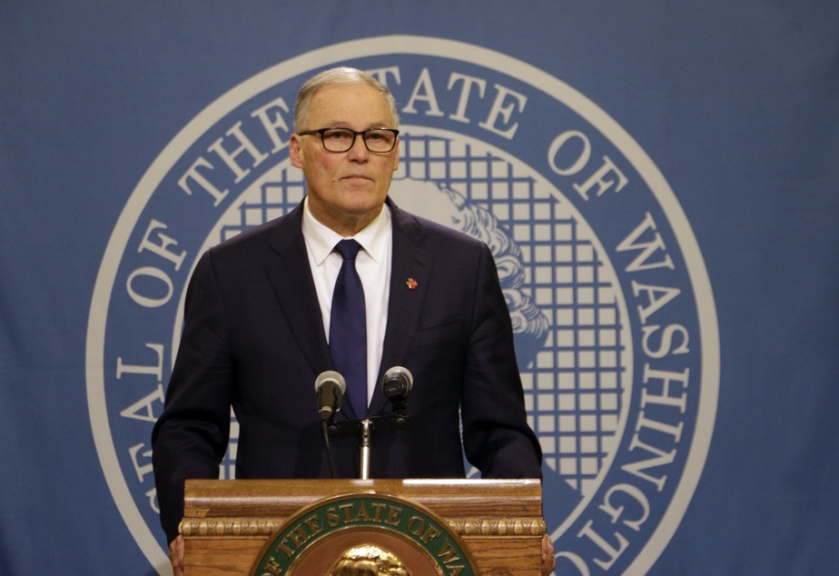 caption: Washington Gov. Jay Inslee speaks to the media after the Legislature adjourned its 60-day session, Thursday, March 12, 2020, in Olympia, Wash. State lawmakers passed a supplemental budget with funding for the state's response to COVID-19.