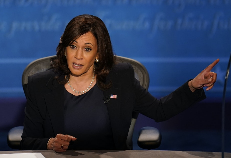 caption: Democratic vice presidential candidate Sen. Kamala Harris responds to Vice President Pence during Wednesday's debate in Salt Lake City.