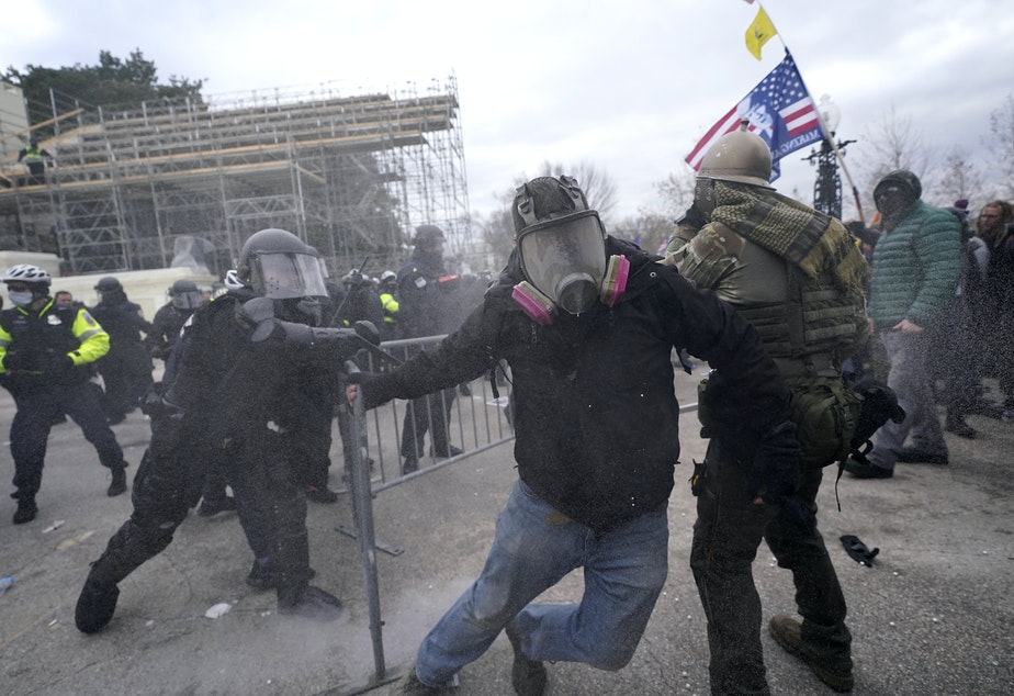 caption: Trump supporters try to break through a police barrier during protests at the U.S. Capitol today, prompting U.S. Capitol Police to take further security measures.
