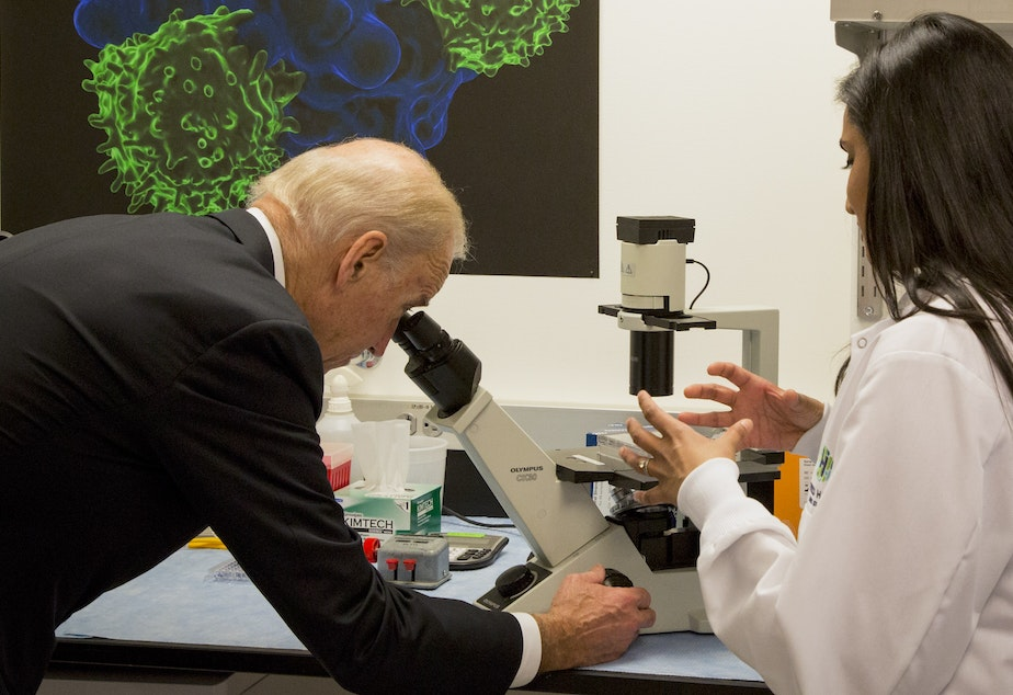 Vice President Joe Biden toured the lab at Fred Hutchinson Cancer Research Center before holding a roundtable meeting with scientists there. Biden says he's encouraged to see more cooperation between researchers and doctors.