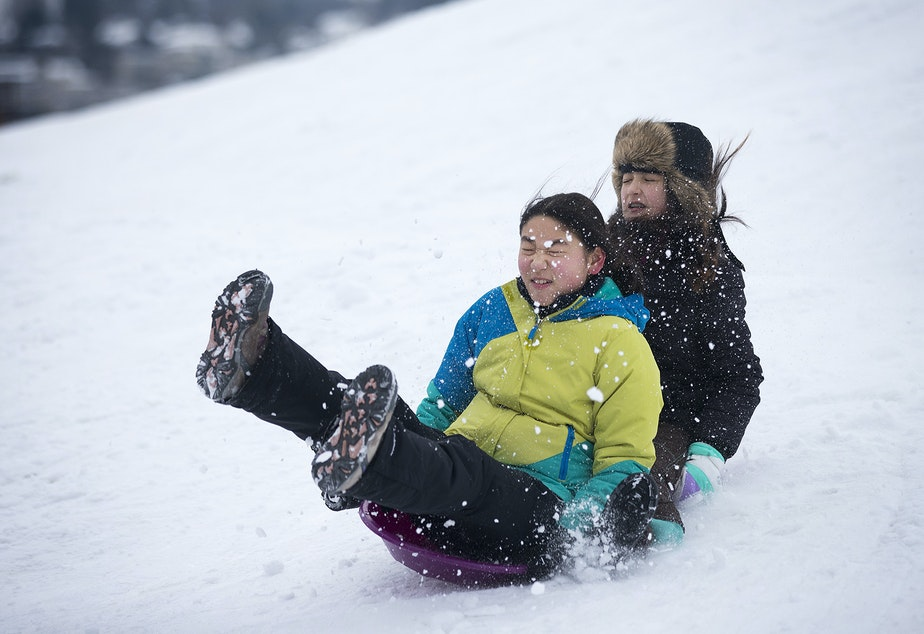 Sarah Kameda, 12, left, and Kumi Long, 12, sled on Monday, February 11, 2019, at Gas Works Park in Seattle. Tap or click on the first image to see more.