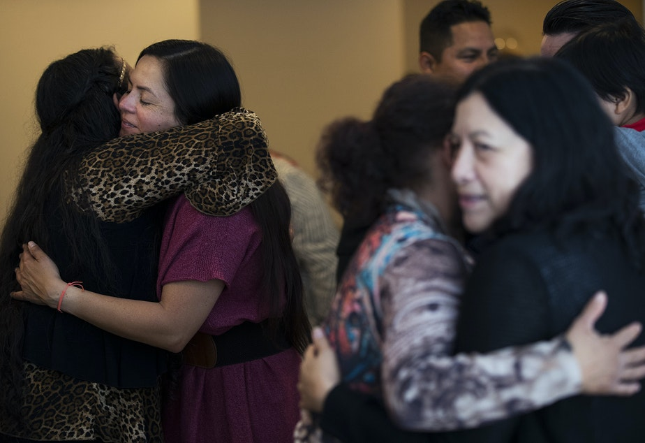 Magdalena Lopez-Muñoz, left, hugs Violeta Sialer before a church service begins in the basement of Nathan Robert's home on Sunday, September 16, 2018, in Des Moines.