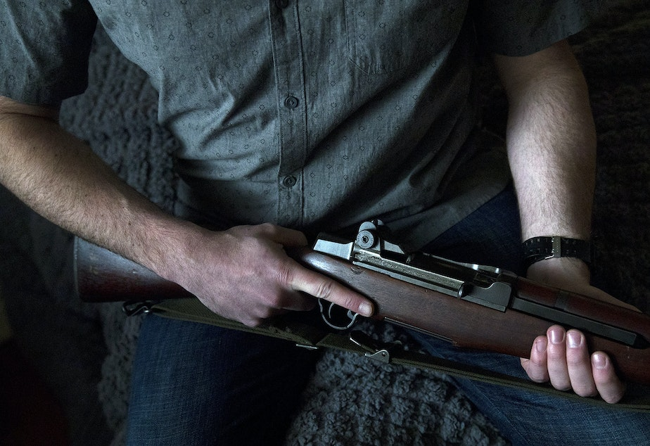 caption: FILE: A Seattle gun owner holds his M1 Garand firearm on Friday, February 21, 2020, at his home.