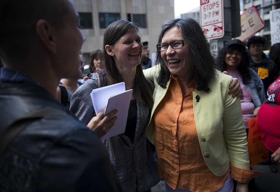 Maru Mora-Villalpando, right, smiles with Murphy Mitchel before her ICE hearing on Tuesday, June 26, 2018, outside of the Immigration Court building on 2nd Avenue in Seattle.