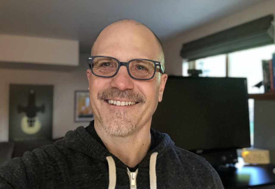 caption: Patrick O'Kelley at his home office in Seattle. He works for Bungie, in Bellevue, but hasn't spent much time there in the last year.