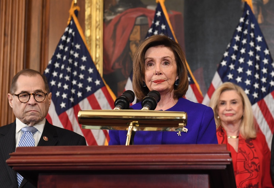 caption: House Speaker Nancy Pelosi and the chairs of investigative committees announce the articles of impeachment against President Trump on Tuesday.