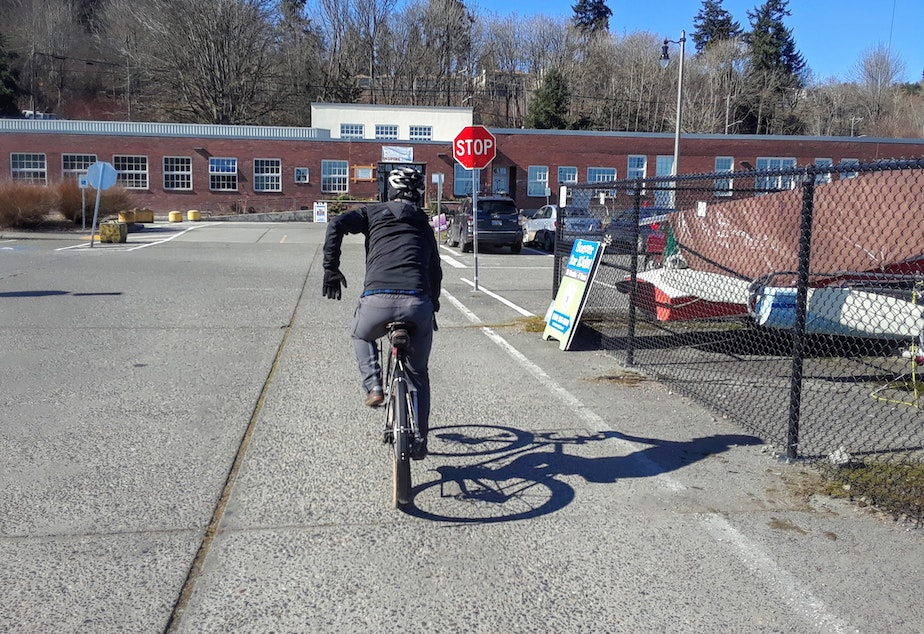 Cascade Bicycle Club's Ryan Young teaches people how to ride safely. He says bicyclists should think of themselves as vehicles and yield to pedestrians.