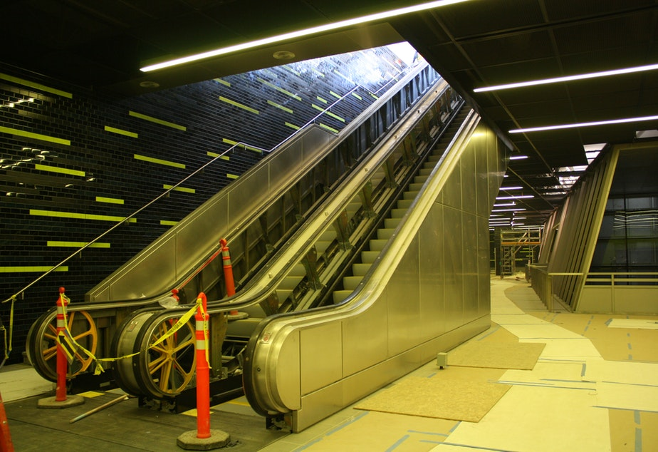 The first of many escalators to descend 90 feet below ground to the light rail platform. The station is scheduled to open spring 2016.