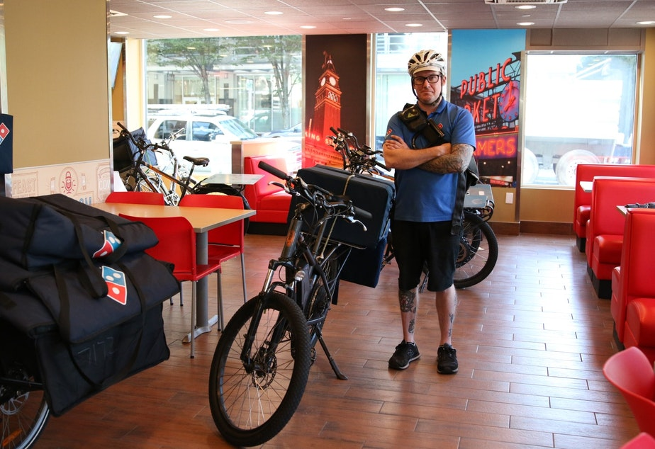 Nick Knudtson delivers pizzas by bike at the Belltown Domino's