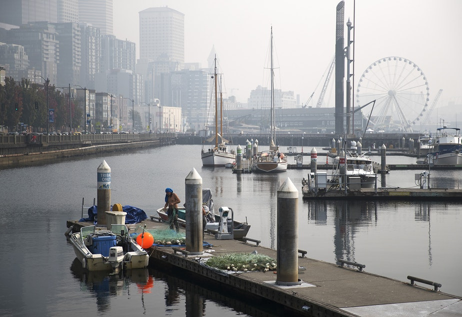 caption: Downtown Seattle is shrouded with smoke from wildfires burning in California and Oregon on Friday, September 11, 2020.