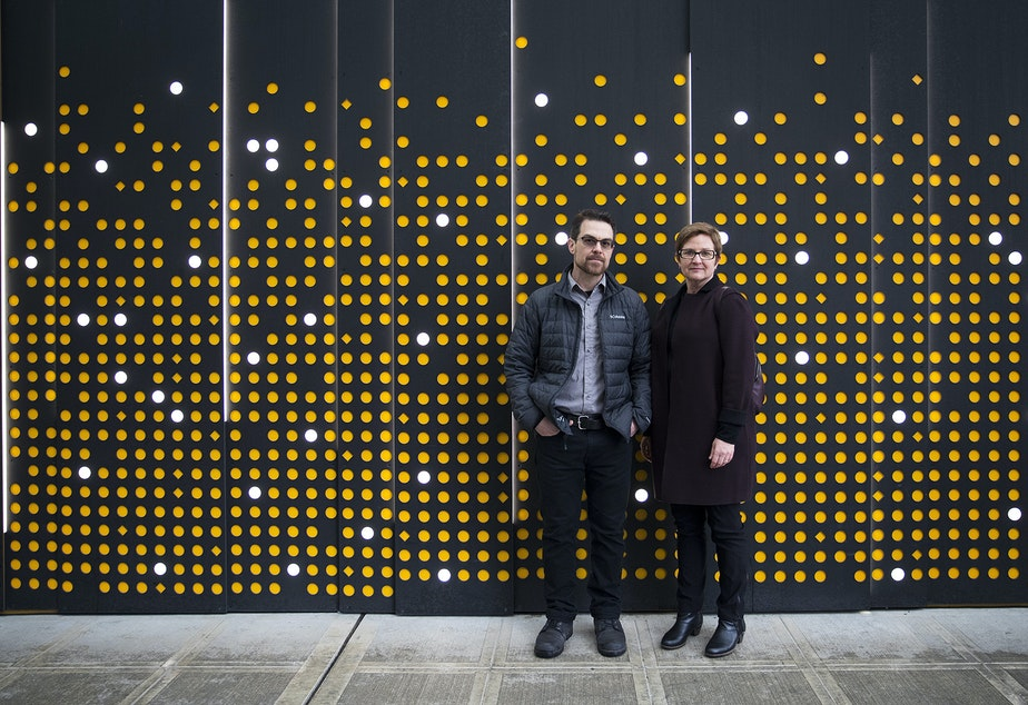 caption: Carolyn Adolph and Joshua McNichols, hosts of KUOW's Primed podcast, pose for a portrait on Thursday, January 24, 2019, at Amazon's spheres in downtown Seattle.