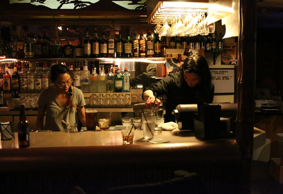 caption: Alan Sato and Sarah Moriguchi tend bar at Bush Garden