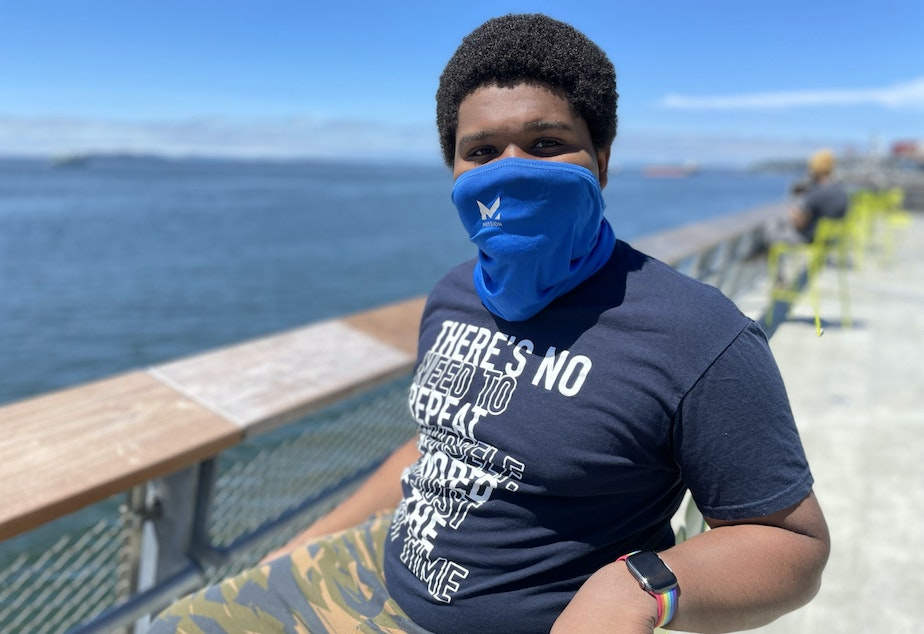 caption: Tristan Watkins is visiting Seattle's waterfront from Chicago.