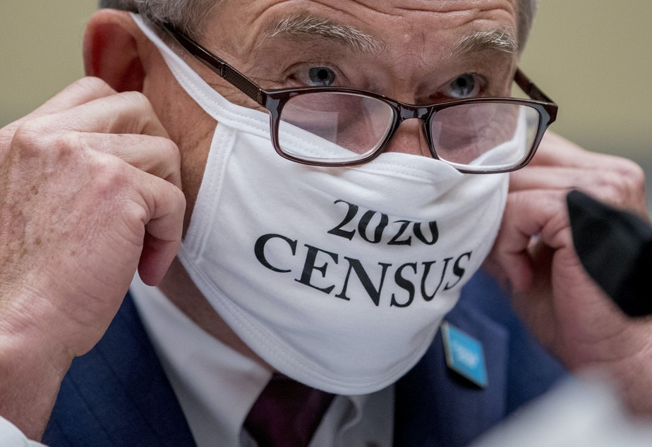 "caption: Census Bureau Director Steven Dillingham, wearing a face covering printed with the words ""2020 Census,"" testified before the House oversight committee Wednesday that the bureau plans to finish counting ""as soon as possible"" despite career officials previously saying they need until Oct. 31 to finish a complete national head count."