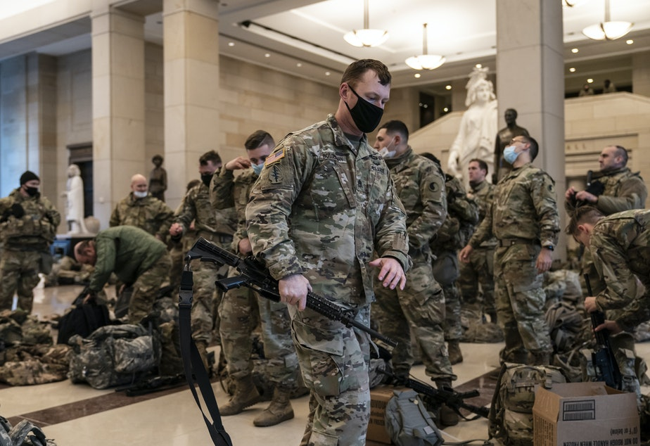 caption: National Guard troops are inside the U.S. Capitol Visitor Center to reinforce security Wednesday at the Capitol in Washington. It comes a week after an insurrection at the Capitol.