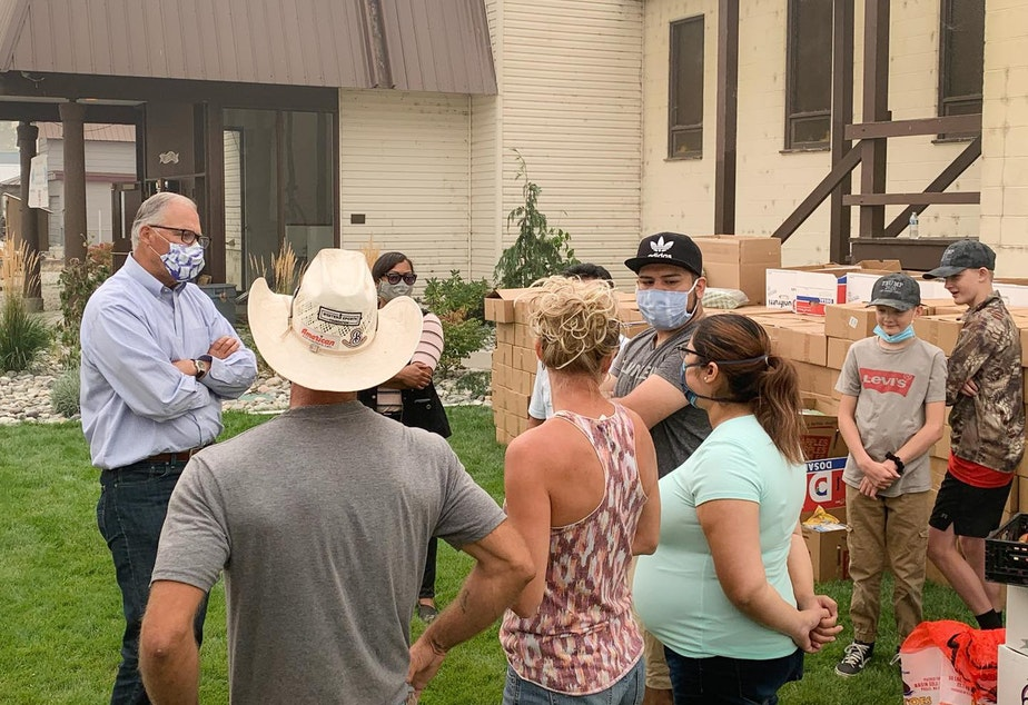 caption: Gov. Jay Inslee pays a visit to Bridgeport, Washington on Saturday, Sept. 12. He brought apples.