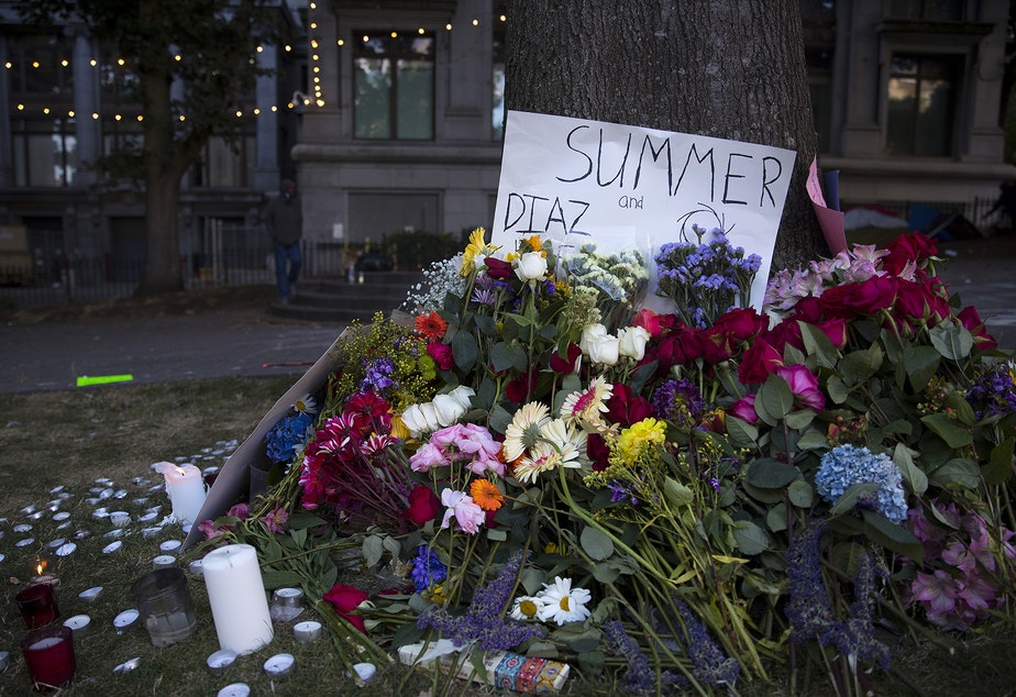 caption: A memorial for Summer Taylor and Diaz Love is shown on Wednesday, July 22, 2020, at City Hall Park in Seattle.
