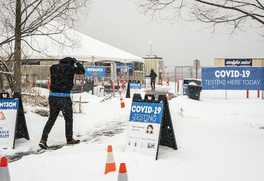caption: The Biden administration announced on Wednesday a range of initiatives to expand testing capacity in the U.S. A COVID-19 testing site in Seattle is seen here on Saturday.
