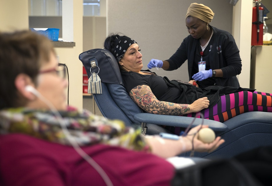 Lisa Ferguson gives blood on Monday, December 18, 2017, at Cascade Regional Blood Services in Puyallup.