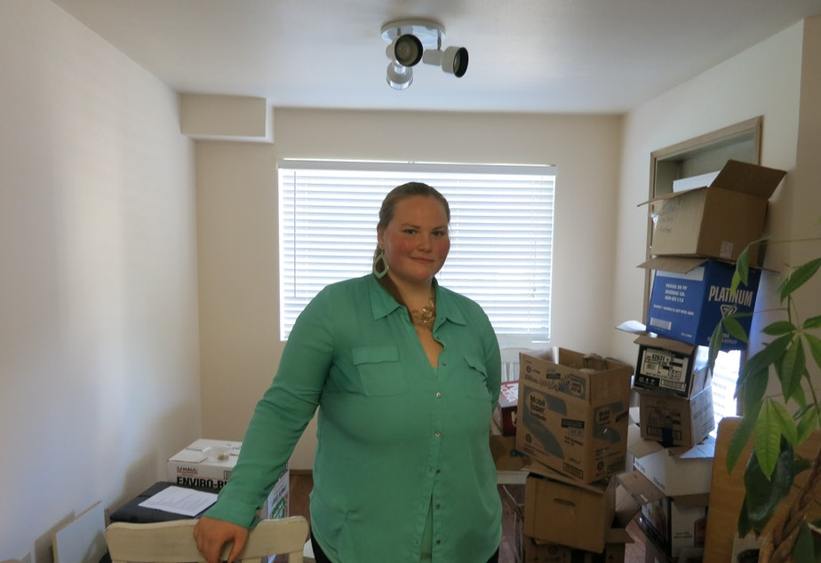 caption: Anelise Moon-Schruder, 24, shown here in her Lake City apartment, is part of the white anti-racist movement.