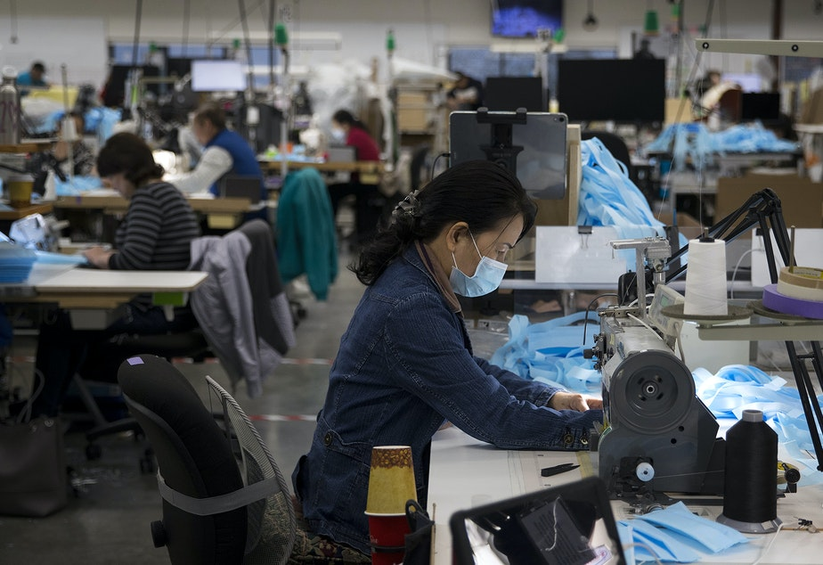 caption: Kaas Tailored employees sew masks on Monday, March 23, 2020, at the Kaas Tailored furniture factory in Mukilteo.