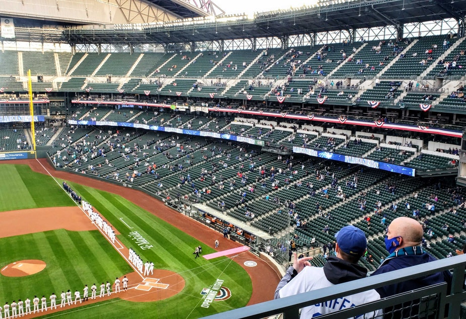 caption: Small clusters of fans dot T-Mobile Park stadium on Opening Day. Thursday, April 1, 2020