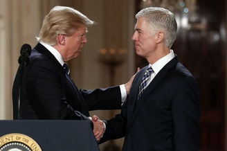 President Donald Trump shakes hands with appeals court Judge Neil Gorsuch, his choice for Supreme Court associate justice in the East Room of the White House in Washington, Tuesday, Jan. 31, 2017.