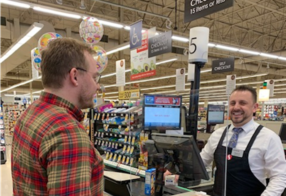 caption: Albertsons and Safeway stores will temporarily install Plexiglas dividers at checkout stands as the COVID-19 crisis continues in Washinton.