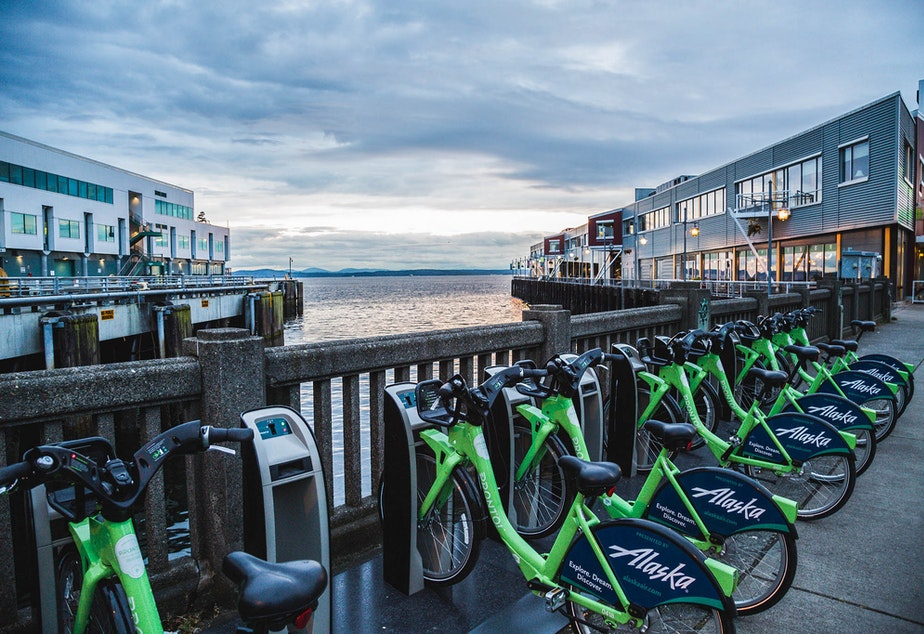 caption: Pronto bikes on the Seattle waterfront. The City of Seattle voted to buy the nonprofit, even though it wasn't doing well financially.