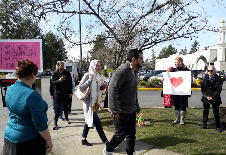 A small crowd gathers to support worshipers as they leave prayers at the Muslim Association of Puget Sound in Redmond on Friday, March 15, 2019.