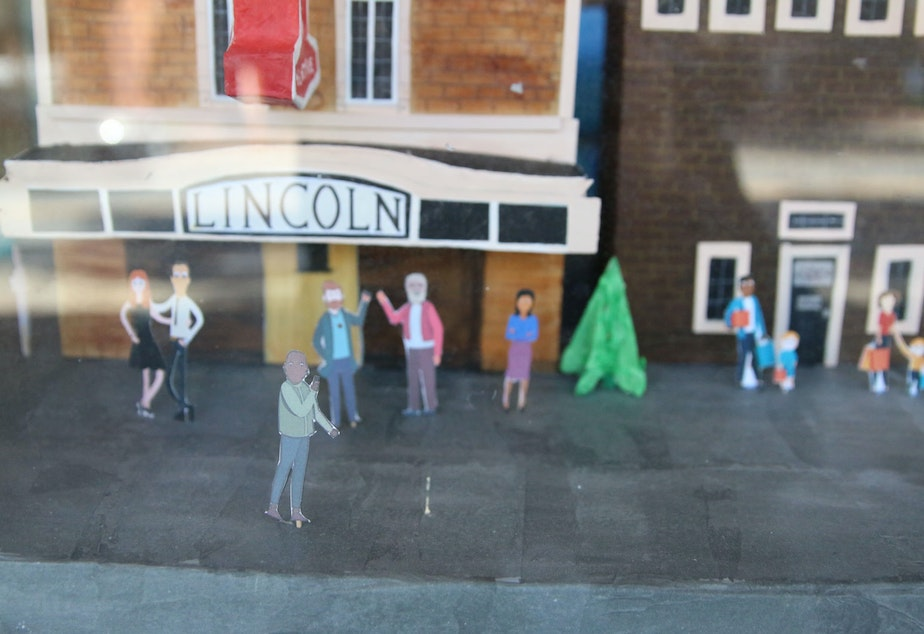 caption: A window display outside the Lincoln, prepared for a Tulip Festival window display competition