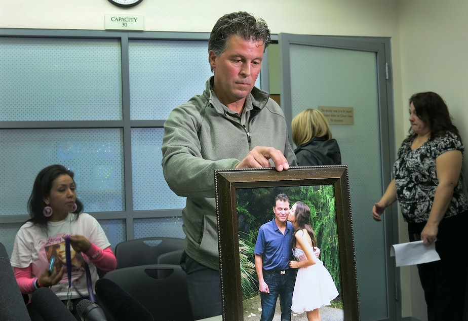 Bryan Soriano holds a photo of him with daughter Gia before her first and only Homecoming dance.