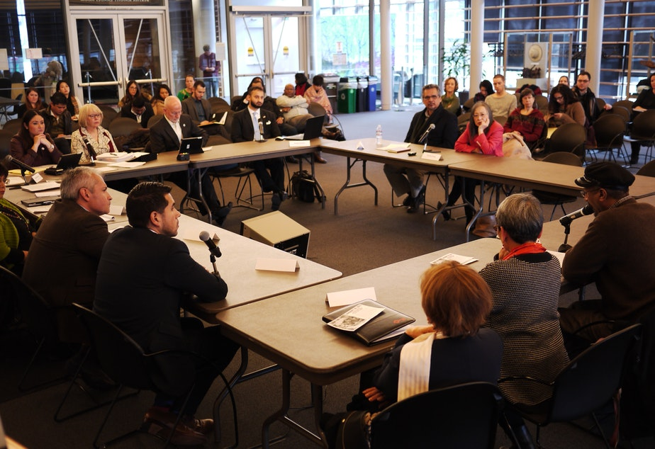 caption: Seattle City Council members hold roundtable discussion with immigrant and refugee service providers.