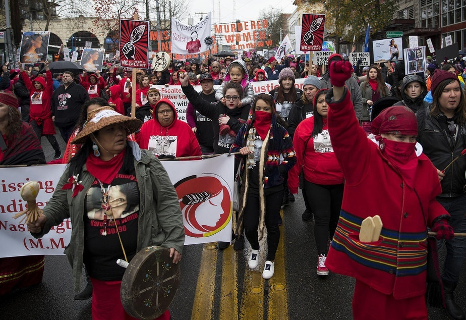 caption: Missing and Murdered Indigenous Women of Washington group members start the Women's March on Saturday, January 20, 2018, on Pine St., in Seattle.
