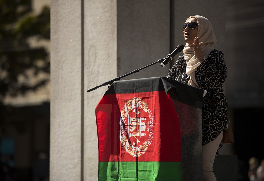 """caption: Zarby Kakar speaks to a crowd of about 100 people standing in solidarity with Afghans on Saturday, August 28, 2021, at Westlake Park in Seattle. """"We can never stop fighting for our people,"""" said Kakar. """"I remember as a refugee coming into this country, the greatest medicine that my mother and I received was meeting another Afghan. Do not forget your people,"""" said Kakar.  """"Welcome them with open arms."""""""