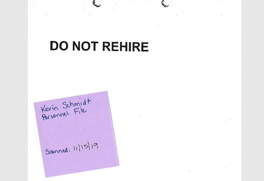caption: The front of Kevin Schmidt's personnel file at Seattle Public Schools. The sticky note was placed there by district officials.