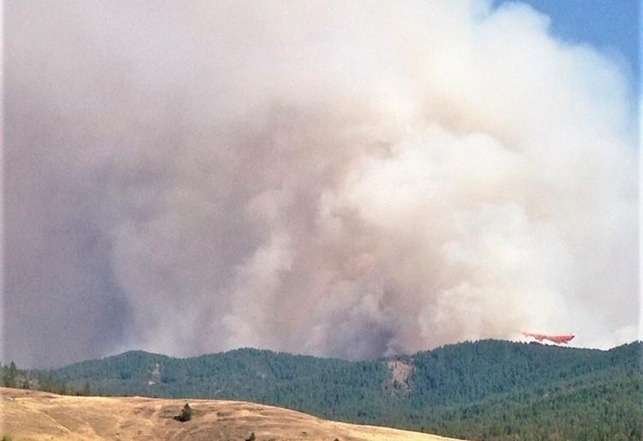 caption: The Williams Flats Fire started from a lightning strike Aug. 2, 2019 near Keller, Washington, on the reservation of the Colville Confederated Tribes.