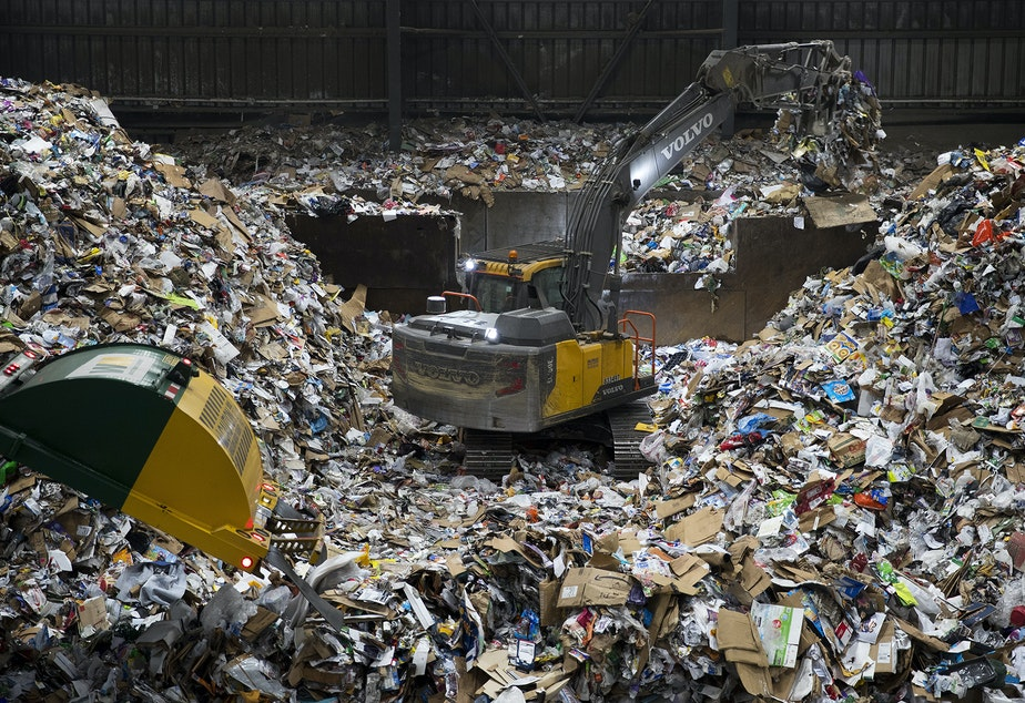 caption: A large pile of recyclables forms where arriving trucks dump the materials before they are sorted on Friday, October 26, 2018, at Cascade Recycling Center in Woodinville.
