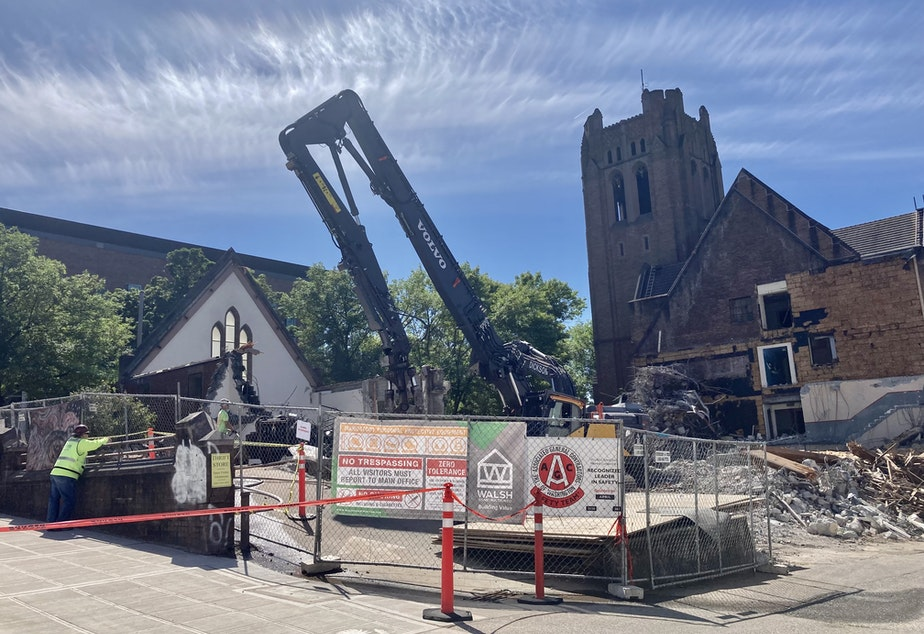 caption: The historic University Temple United Methodist Church on 15th Avenue in Seattle's University District was demolished on June 18, 2021.