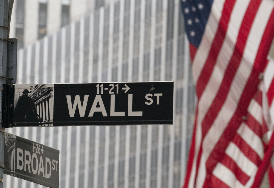caption: A street sign for Wall Street is seen outside the New York Stock Exchange on Nov. 5, 2020. Stocks rallied after Moderna said its experimental COVID-19 vaccine was nearly 95% effective.