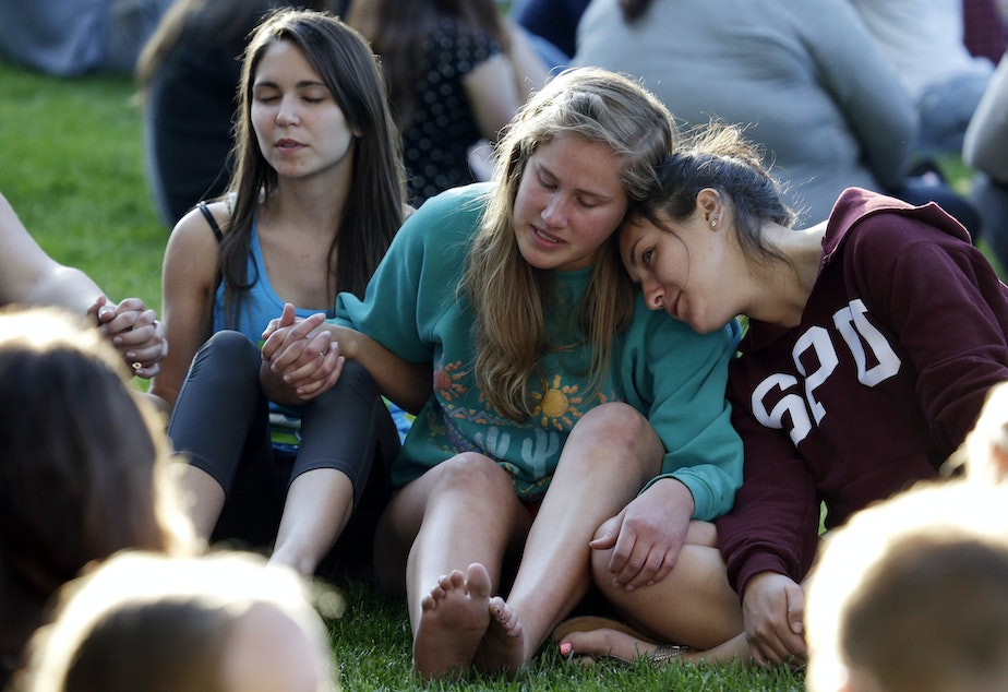 Seattle Pacific University students pray and comfort each other the day after a campus shooting on Thursday, June 4, 2014.
