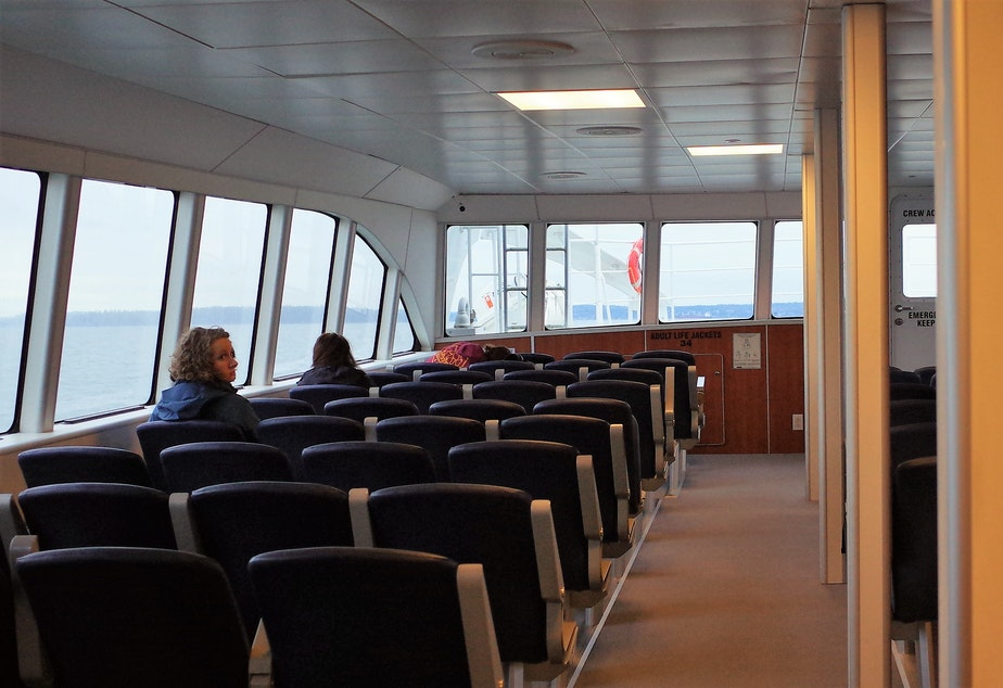 caption: The fast ferry to Bremerton on a weekday morning. Morning runs from the Seattle side to Bremerton often have few passengers. Bremerton-side passengers experience uncertainty over whether they can find a seat on the vessel.