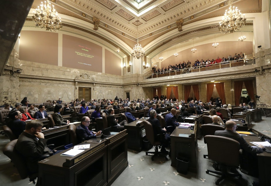 Washington House representatives listen to testimony, Thursday, Jan. 24, 2019, before they unanimously voted to approve a code of conduct for the Legislature in Olympia, Wash.